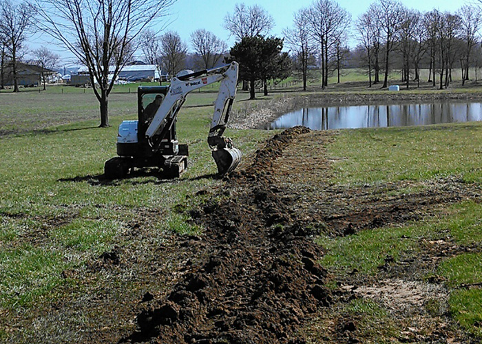 trenching toward pond
